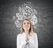 Frauenträume über glänzende Dollar, Tafel Stockfotografie