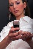 Frauenvorwahlknopf ein Telefonnummer Lizenzfreies Stockfoto