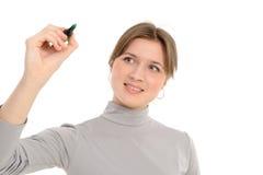 Frauenzeichnung etwas auf Bildschirm mit einer Feder Lizenzfreies Stockbild