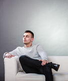 Fraught, bored man husband waiting for woman wife. Stock Photography