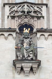 Fraumunster Church King Zurich Switzerland. Detail of a king with a golden crown and a sword statue at the adorned facade of Fraumunster church Royalty Free Stock Photography