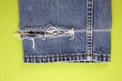 Frayed denim jeans Stock Image
