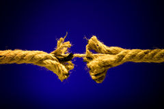Frayed rope breaking Stock Images