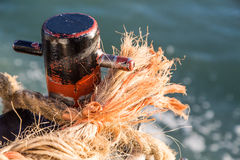 Frayed Rope on Rusty Cleat Royalty Free Stock Images