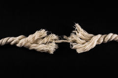 Frayed Rope and Thread on Black Background Royalty Free Stock Photos