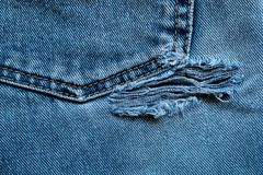 Frayed and torn old jeans. Stock Photo