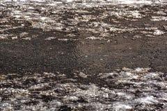 Frazil da estrada com sal Frost após a aproximação amigável foto de stock royalty free