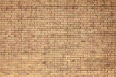 Färben Sie Backsteinmauer-Hintergrund gelb Stockfotografie