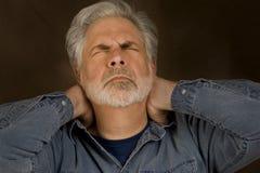 Fördjupning eller spänning för huvudvärkhalsknip Arkivfoto