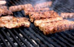 Freír la carne Foto de archivo libre de regalías