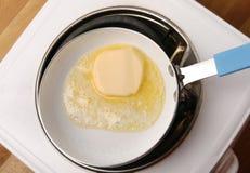 Freír la fusión de la mantequilla Fotografía de archivo