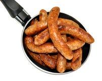 Freír a Pan Full Of Sausages Imagenes de archivo
