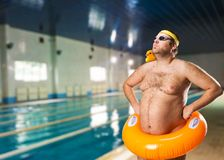 Freak man in the pool Royalty Free Stock Photography