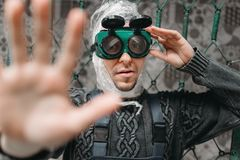 Freak man in swimming goggles pulls out his hand Royalty Free Stock Photo