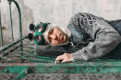 Freak man wraps his head in film and lies in bed Royalty Free Stock Images