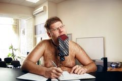 Freak naked businessman. Works in office Royalty Free Stock Photos