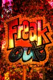 Freak Out neon sign, in vibrant orange, red, yellow and blue colours stock photo