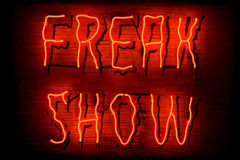 Freak Show neon sign. Red neon sign of the words 'Freak Show' on a black background Royalty Free Stock Photography