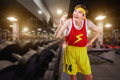 Freak is a thin man with a medal in the gym. Concept humor sports Royalty Free Stock Photos