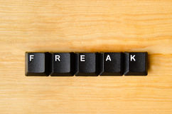 Freak word. With keyboard buttons Royalty Free Stock Image