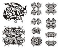 Freakish dragon symbols. Tribal dragon head design collection Royalty Free Stock Photography