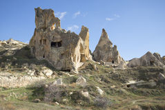 Freakish rocks with remnants of ancient dwellings of christians in the surrounding area of Goreme. Cappadocia Stock Photo