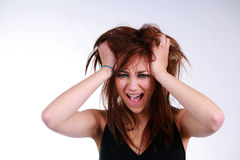 Freakout. Girl with messy hair and makeup crying royalty free stock image