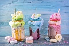 Freakshakes with donuts. And candy floss stock photos