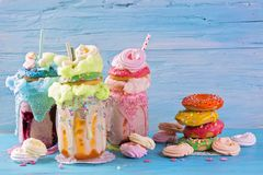 Freakshakes with donuts. And candy floss stock photo