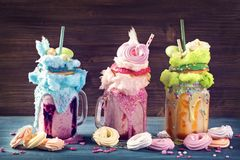 Freakshakes with donuts. And candy floss royalty free stock photos