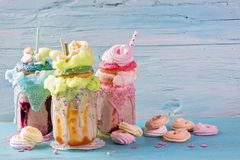 Freakshakes with donuts. And candy floss royalty free stock photo
