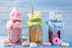 Freakshakes with donuts. And candy floss royalty free stock photography