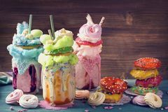 Freakshakes with donuts. And candy floss royalty free stock image