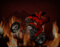 Freaky Devil with clipping path. A freaky devil rides the hell bike amongst the flames of you know where Stock Image