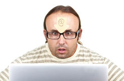 Freaky-man-obsessed-with-internet Royalty Free Stock Photos