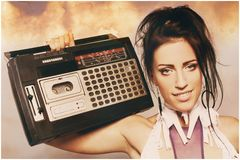 Freaky woman with old fashioned tape recorder Stock Photo