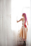 Freaky young female model wearing corset Royalty Free Stock Photos
