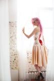 Freaky young female model wearing corset Stock Photo