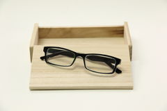 Fream Spectacles eyeware on wood box Stock Photos
