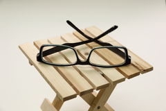 Fream Spectacles eyeware on wood box Royalty Free Stock Photography