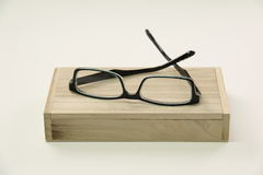 Fream Spectacles eyeware on wood box Royalty Free Stock Photos
