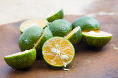 Freash of calamansi cut on wood background Stock Image