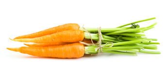 Freash carrots with leaves. On white Royalty Free Stock Photo
