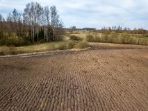 Freashly cultivated fields in countryside ready for agriculture. Aerial view of naked soil royalty free stock photos