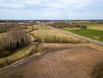 Freashly cultivated fields in countryside ready for agriculture. Aerial view of naked soil royalty free stock photo