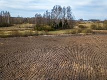Freashly cultivated fields in countryside ready for agriculture. Aerial view of naked soil royalty free stock image