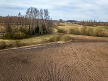 Freashly cultivated fields in countryside ready for agriculture. Aerial view of naked soil stock image