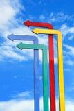 Frecce colorate nel fondo del cielo blu Fotografia Stock