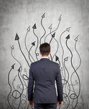 Frecce del disegno e dell'uomo d'affari Fotografia Stock Libera da Diritti