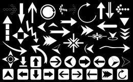 Frecce su fondo nero Fotografie Stock Libere da Diritti